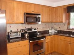 honey oak kitchen cabinets | here is another kitchen corner with a