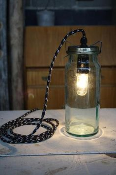 Lamp made from recycled canning jars and Bakelite light fixtures.