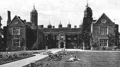 Children relaxing on the lawn in front of Melford Hall in 1901 © Countrylife