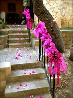 Pretty and pink party decorations ~ MOM has a railing that something like this would look cute on.