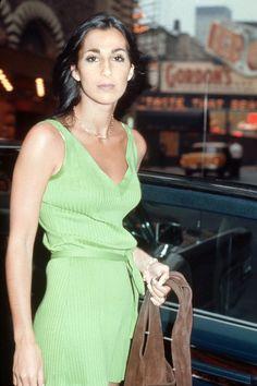 Cher in a soft green dress