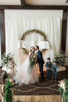 ceremony kiss - photo by Samantha Jay Photography http://ruffledblog.com/enchanted-garden-wedding-ideas