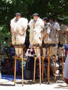 Stilt Dancers from France...early shepherds would use stilts to watch over their flocks...wool vests