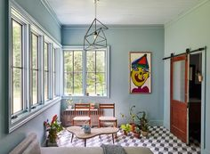 A design-obsessed couple shares the story behind their two-year-long historic home renovation