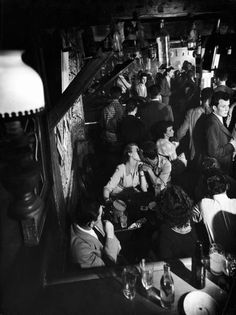 Nightlife in Paris, 1949 - A couple kiss in a crowded nightclub