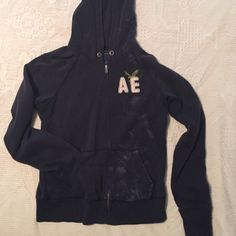 American Eagle navy zip up hoody. Gently used zip up hoody w/o draw strings. American Eagle Outfitters Tops Sweatshirts & Hoodies