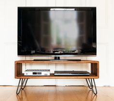 Midcentury Modern TV table / Credenza in Iroko and raw iron hairpin legs on Etsy, $941.10