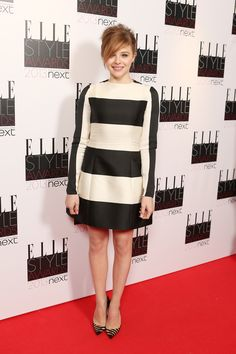 Future Fashion Icon award winner Chloe Moretz in a black and cream striped dress from our Autumn 2013 collection at the Elle UK Style Awards.