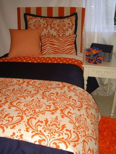 Love the orange! Must have this as a guest room!