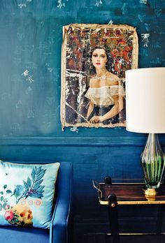 Love the way the paint is worn out and faded. love color + Beautiful antique art hanging