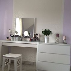 Minimalistic vanity table - easy to create from Ikea malm dressing table and a large mirror.