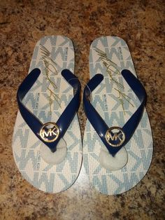e72ee99aa46ac2 Michael Kors EVA White with Gold Logo Womens Size 7M Flip Flops Sandals MK   fashion