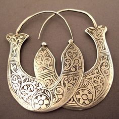 China | Earrings; silver from Guizhou (Miao).  The Yi from Yunan also were simpler type earrings | Sold | Much larger versions of these earrings (where the weight can exceed 15kgs) are also worn by the Lao Lan Tien girls of Laos during festivities.