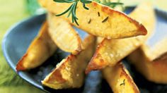 Craving french fries? Whip up these oven-roasted sweet-potato wedges instead. A healthier way to satisfy those cravings, this recipe delivers more taste too, with a kick provided by mustard, garlic, and rosemary.