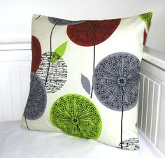 I really like this fabric. Could a cool color scheme for our living room.