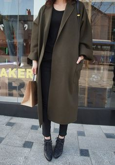 The colour and shape of this coat, perfect with black.
