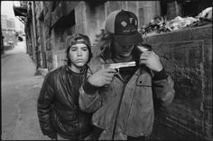 "Mary Ellen Mark's legendary photographs –""Rat"" and Mike with a gun, Seattle, Washington, 1983"
