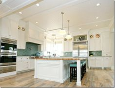 LOVe this inspiration kitchen by Benjamin Blackwelder, ceiling, cabs, huge square island with stools hidden