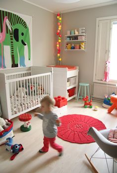 nursery in finland - love the poster behind the crib