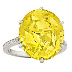 Rare Handmade Yellow Sapphire Diamond Platinum Ring | From a unique collection of vintage cocktail rings at https://www.1stdibs.com/jewelry/rings/cocktail-rings/