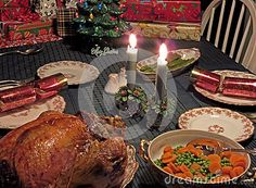 Traditional Canadian Christmas dinner: turkey with dressing (stuffing), gravy and vegetables on a table set for dinner.