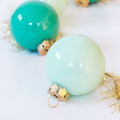 Create custom colored ornaments in just the right hue by filling glass ball ornaments with craft paint.