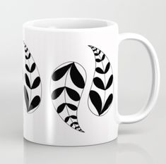 Black and white paisley coffee mug by Emma Freeman Designs available on Society6
