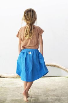 61cb1b40d372 Really love this vibrant blue skirt paired with the soft clay tee.  Separates done right