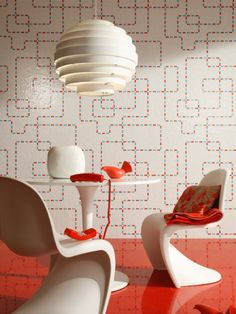 Retro patterns paired with space-age furniture and lacquered floors combine to create a unique, contemporary dining space #tiling