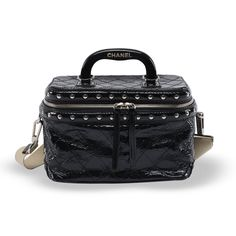 A Chanel Black Distressed Patent Train Case. This bag features a solid black top handle emblazoned with the Chanel logo, an optional adjustable white canvas shoulder strap with studs, and silver hardware featuring a wrap around ...