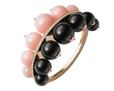 Cartier bracelet from the Évasions Joaillières Collection in pink gold, set with pink opals, onyx and diamonds.