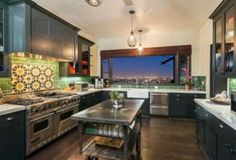 Megan Fox (Transformers, Teenage Mutant Ninja Turtles) and Brian Green (David on Beverly Hills 201210) have their home on the market in LA - for under $4 Mil. Here's the kitchen (MLS)
