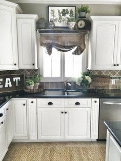 Farmhouse kitchen decor. Shelf over sink in kitchen.