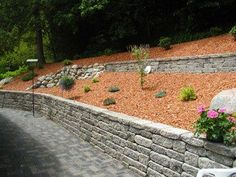 Tiers break up a long wall and allow room for plantings between them. Product used: Mosaic