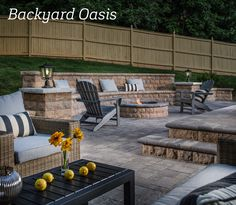 A backyard oasis complete with a fire pit, seat wall and another seating area.