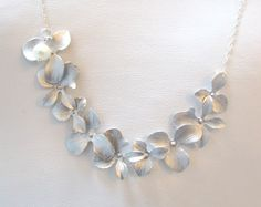 Silver cascading orchids on sterling chain.