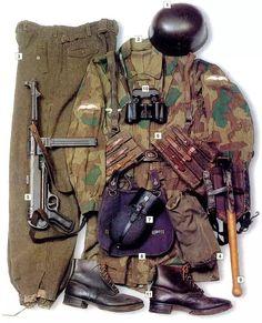 "Fallschirmjäger Unteroffizier (Corporal), 1944 / 01 - Fallschirmschützen-Stahlhelm 38 jump helmet 02 - Fallschirmschützen Bluse camouflage sweatshirt in ""Splittermuster"" camo, rank insignia on the sleeves, Luftwaffe eagle on the right breast 03 - M-37 trousers 04 - M-38 gas mask in a tarpaulin bag 05 - 9 mm MP-40 SMG 06 - ammo pouches for MP-40, main belt and webbing 07 - M-31 canteen in ""Fliegerblau""- ""aviation blue"" 08 - M-31 breadbag 09 - folding shovel 10 - Ziess 6x30 binoculars 11…"