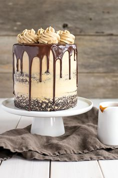 This Chocolate Dulce De Leche Cake from Liv for Cake has rich chocolate cake layered with silky caramel buttercream and drizzled dulce de leche!  via @bestblogrecipes