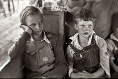 Migrant children heading west in the back seat of the family car somewhere east of Fort Gibson in Muskogee County, Oklahoma June, 1939
