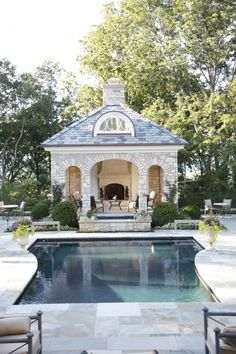 Beautiful pool pavilion with fireplace near Nashville. Natchez Stone Company.