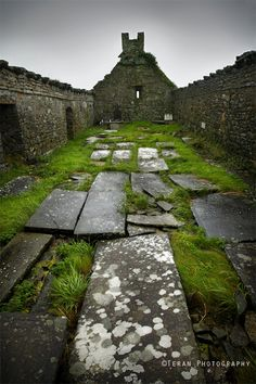 In the remote countryside of Ireland an ancient Irish tomb rests silently beneath stormy clouds.