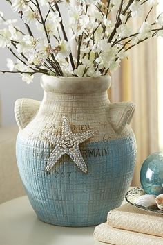 Shaped by hand, Pier 1's Terracotta Starfish Vase is ready to bring relaxed, seaside style to your home or vacation cottage. Its French inscription, crosshatch texture and hand-applied, antiqued color create interest on mantels, by doorways or as the centerpiece in a breezy, seasonal display.
