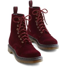 Let your steps do the talking with these velvet Dr. Martens boots! With treaded lug soles and a rich burgundy hue, this lace-up pair grounds your look in atten…