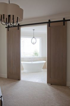 Am getting a single sliding/barn door to replace the pocket door on my masterbath. Something like this.