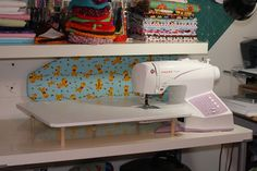 DIY SEWING EXTENSION TABLE. Plywood and wooden dowels.