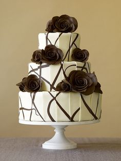 Modern Wedding Cake  Pleated white and dark chocolate modeling paste with chocolate modeling paste roses.