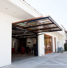 The Premier Single-Piece System in the Market! The Single-Swing is the premier, hydraulically-operated, single-piece door/window in the market, today. Swing Out Garage Doors, Single Garage Door, Sliding Garage Doors, Glass Garage Door, Garage Door Design, Glass Door, Barn Door Garage, Single Swing, Garage Door Makeover