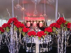 Flowers and chandeliers help make this huge tent elegant and warm.