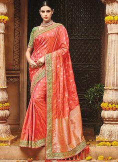 Coral peach saree with blouse. Work - Weaving, foil work and heavy hand work border with hangings. Paired with the matching blouse piece. Coral Saree, Peach Saree, Indian Silk Sarees, Indian Sarees Online, Indian Designer Sarees, Designer Sarees Online, Banarsi Saree, Lehenga Choli, Fancy Sarees