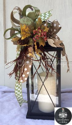 This is a fall floral lantern swag with burlap and printed ribbons, ivory white, moss green pumpkins and greenery. This swag attaches to